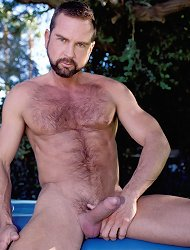 Handsome gay bear naked outdoor and playing with his huge meaty cock by stroking it live