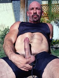 Bald gay bear Steven masturbates outdoors and plays with his balls