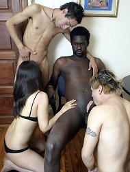 Cute gal joins three bisex guys, one black and two white, to watch their gay train and suck cock