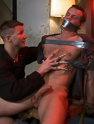 Trent Diesel gets tied up, beaten and fucked in bondage by Brenn Wyson.