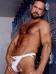 Bear hunk Phil strips down in the locker room and shows off his sexy white briefs