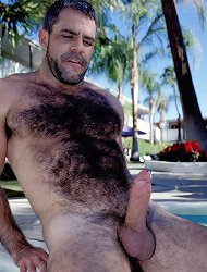 Gay bear hunk Jeremy hangs out by the pool and flaunts his hot bod and huge dick