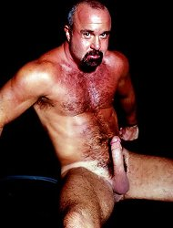 Bear gay hottie Alex strokes his meaty sized staff and plays with his balls