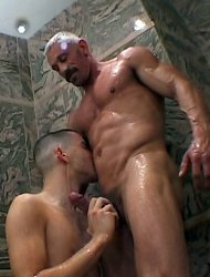 Muscled dad with thick mustache fucks raunchy boy. Sexy lad takes old dick in shower