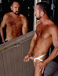 Buffed gay hottie in a locker room taking off his clothes to flaunt his huge erect prick live