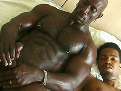 Big black stud works his tool. Huge well-equipped stud