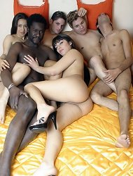 Two sexy lesbians having fun with their hot boyfriend and getting joined by three more men