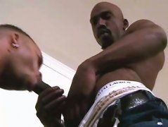 Brown stud gives deep throat job. Cute hunk swallows black meat