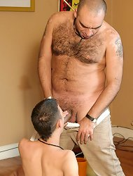 Hairy mature man gets deep throated by a hot twink