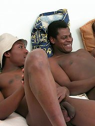 Handsome white twink doing his best to please a trio of lustful black pimps
