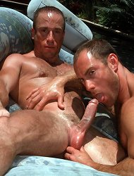 Hunky gay stud getting a wet blowjob