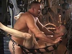 With all the tools handy, these two old guys fuck in a sex swing to orgasm