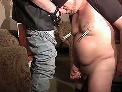 Cock sucking bear gets his nipples clamped, and is forced to lick his master\'s boots clean