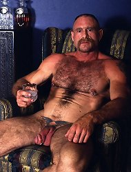Hot gay bear hunk George strokes his pierced huge dick in the living room