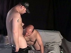 This older bear bends over for his buddy to slide his rigid prick inside of his ass