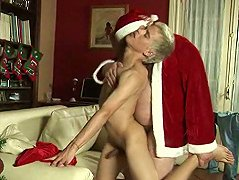 Santa shoots eggnog from his dick on a boy\'s face