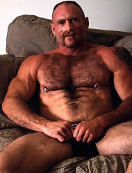 Hot buffed bear gay George plays with his huge pierced erection in the living room