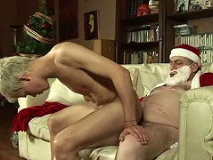 Old Santa fucks a young boy\'s ass on Xmas Eve