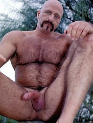 Horny gay daddy in a park and stripping off his clothes to show off his stiff man meat live