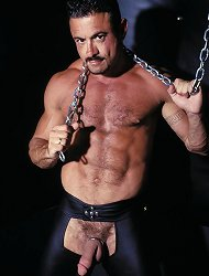 Bear bodybuilder Enrico Rodriguez enjoys some kinky fun with a chain and leather pants in this hot scene