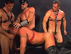 All four leather clad bears got together to play with each other\'s dicks and asses