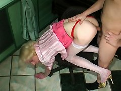 Blond sissy in a pink skirt and a matching blouse enjoys rimjob before anal